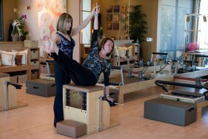 Paula teaching a variation of Torso Press Sit on the Wunda Chair